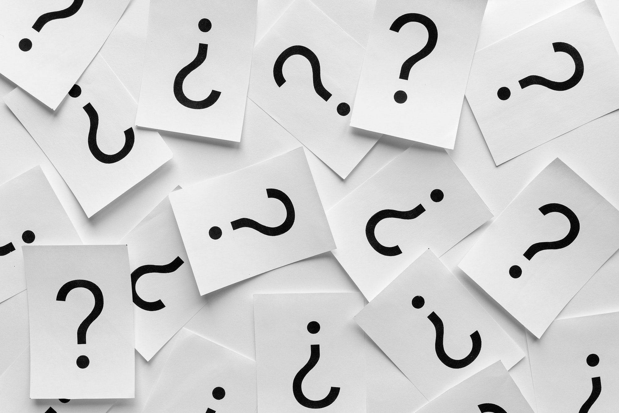 Background texture of printed question marks